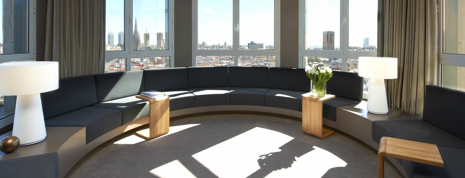 Spacious circular living room perfect for private meetings